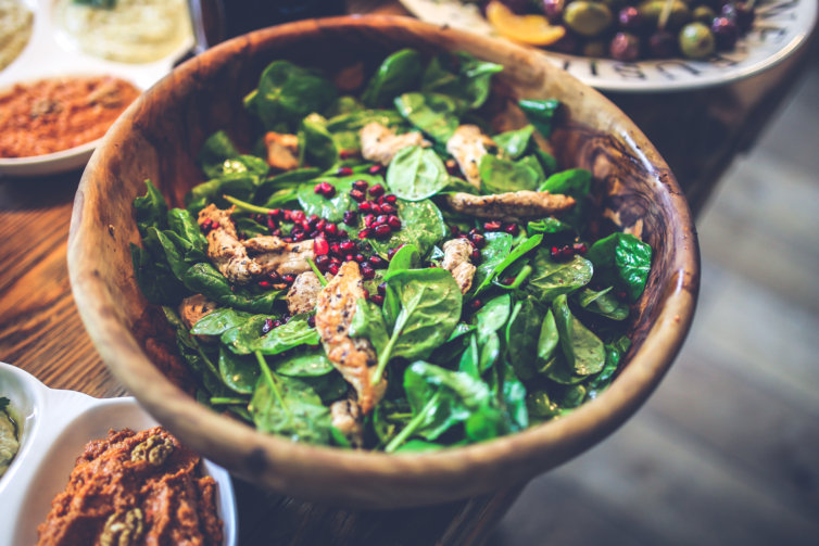 Spinach and pomegranate Caesar salad